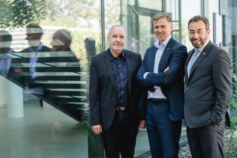 Portraitfoto: Drei Männder der Geschäftsleitung der Firma Esarom
